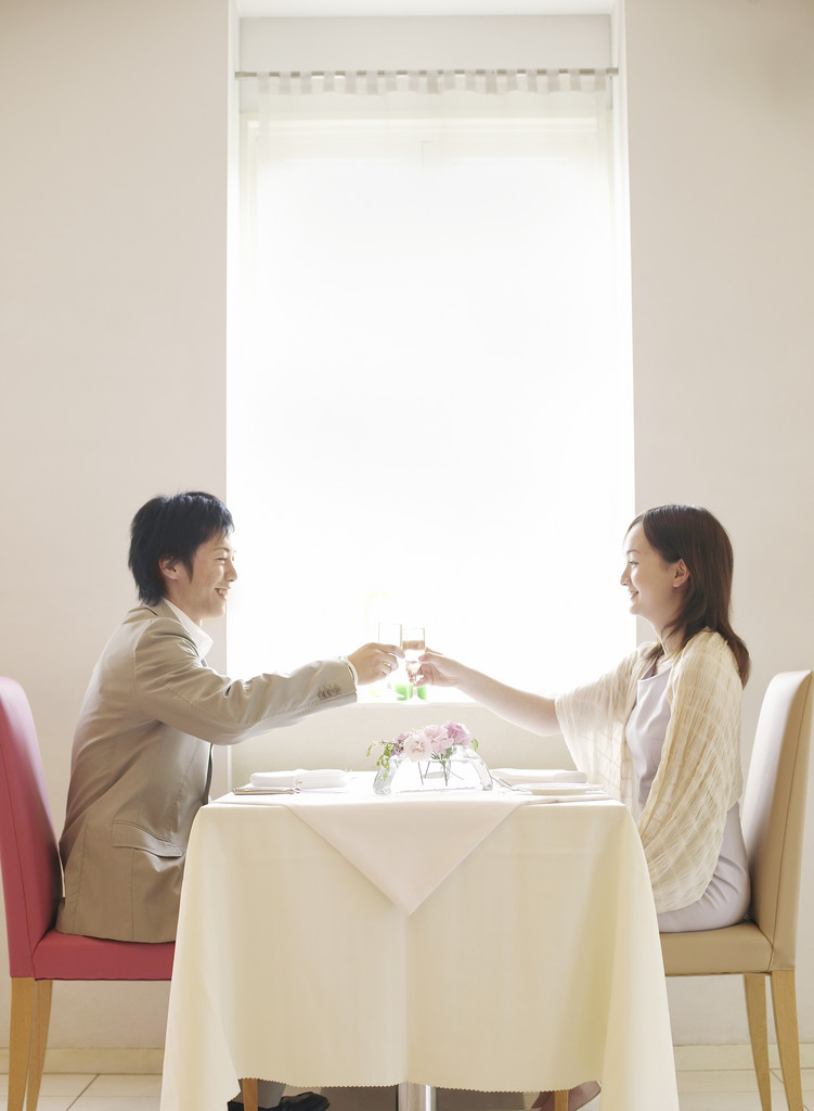 Young Couple in Restaurant Making a Toast