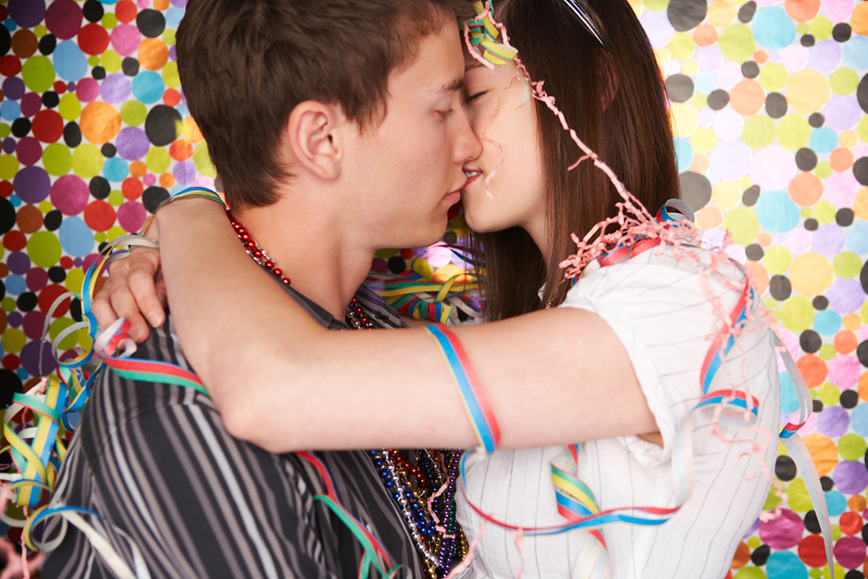 Reserved young teens kissing and